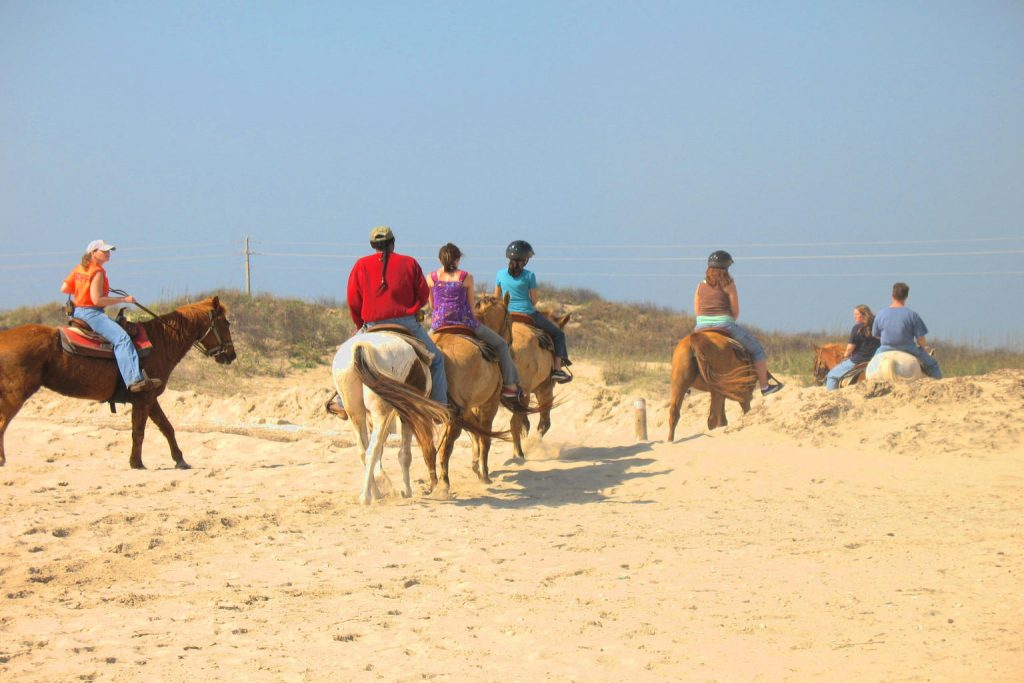 Group of Horseback Riders South Padre Island; CQ Integrative Health