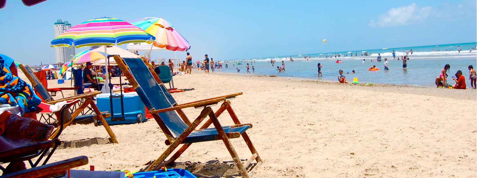 South Padre Island Beach; Sunny Day with Colorful Chairs and Umbrellas; CQ Integrative Health Out of Town Patients