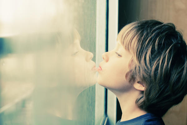 Autistic Child Looking Out Window; CQ Integrative Health Treats Autistic Children 600x400